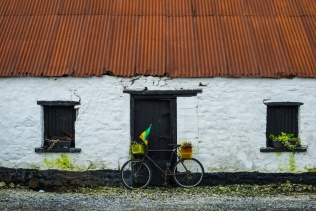 Old Irish stone cottage and bicycle background